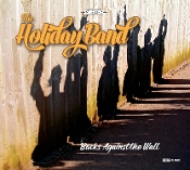 Holiday Band Backs Against the Wall